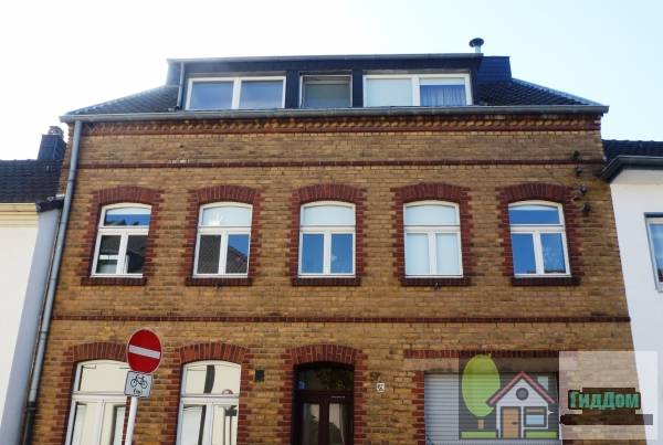 Жилой и деловой дом (Wohn- und Geschäftshaus)